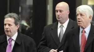 "Richard J. ""R.J"" Vanecko, center, with his attorneys"