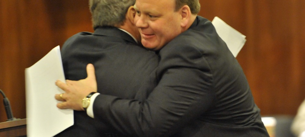 Cook County Commissioner John Daley, left, hugs Patrick Daley Thompson after he is sworn in as  a new commissioner of the Metropolitan Water Reclamation District Board.